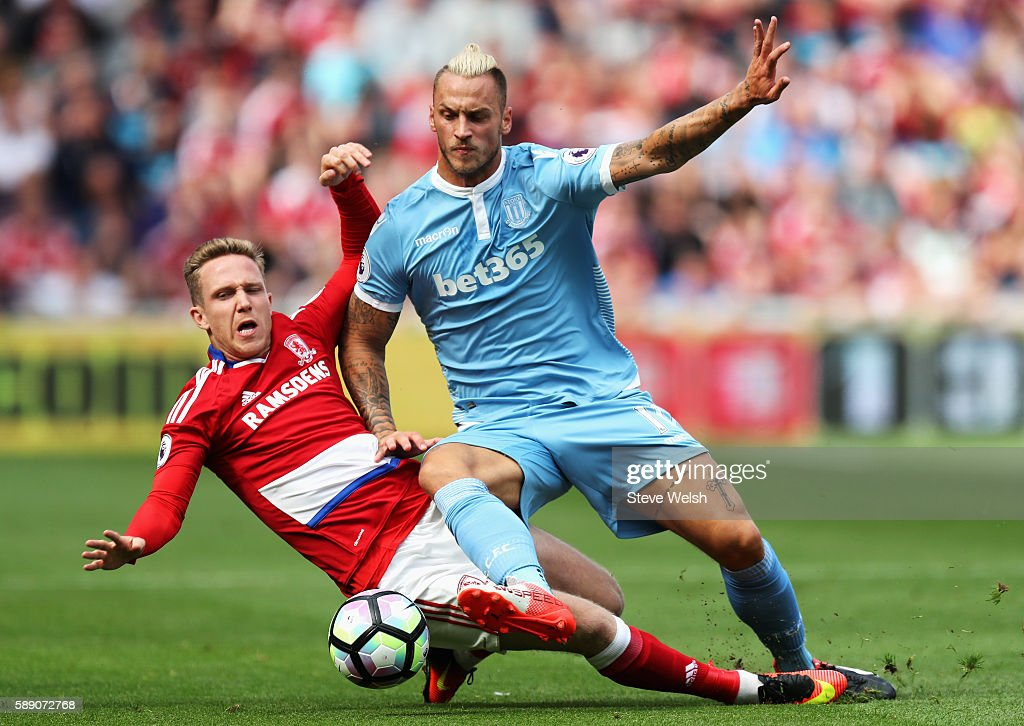 George Friend of Middlesbrough battle for possession with Marko Arnautovic of Stoke City during the Premier League match between Middlesbrough and Stoke City at Riverside Stadium on August 13, 2016 in Middlesbrough, England.