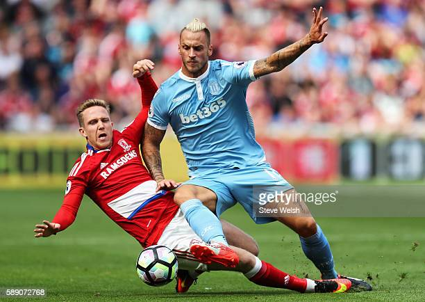 George Friend of Middlesbrough battle for possession with Marko Arnautovic of Stoke City during the Premier League match between Middlesbrough and...