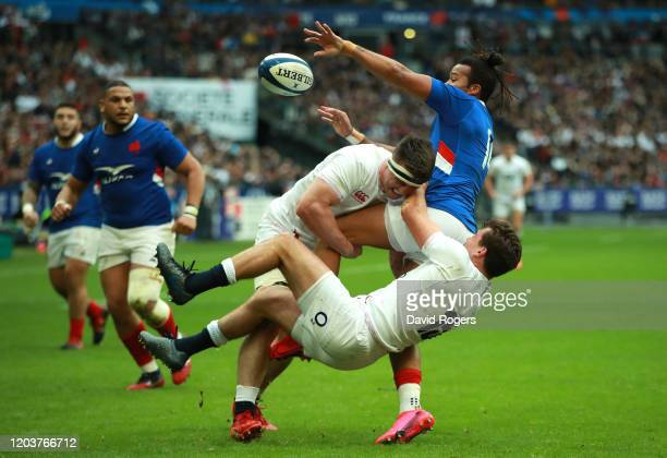 George Furbank and Tom Curry of England tackles Teddy Thomas during the 2020 Guinness Six Nations match between France and England at Stade de France...