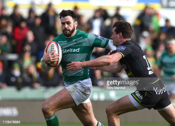 George Furbank of Northampton Saints tackles Alex Dunbar of Newcastle Falcons during the Premiership Rugby Cup Semi Final match between Northampton...