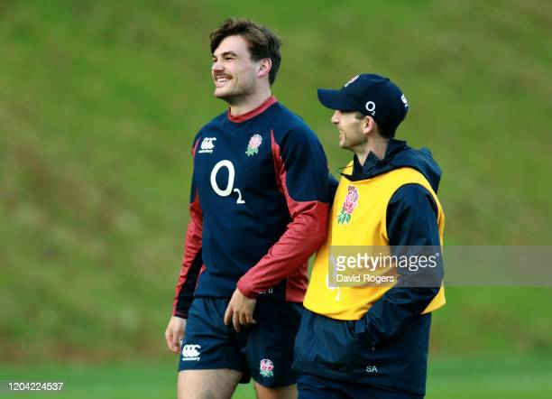 George Furbank talks with backs coach Simon Amor during the England training session held at Pennyhill Park on February 05 2020 in Bagshot England