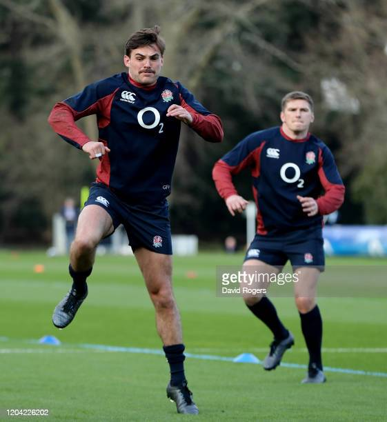 George Furbank warms up with Owen Farrell during the England training session held at Pennyhill Park on February 05 2020 in Bagshot England