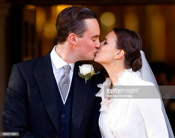 George GalliersPratt and Arabella Musgrave kiss as they leave St Paul's Church Knightsbridge after their wedding on February 8 2014 in London England