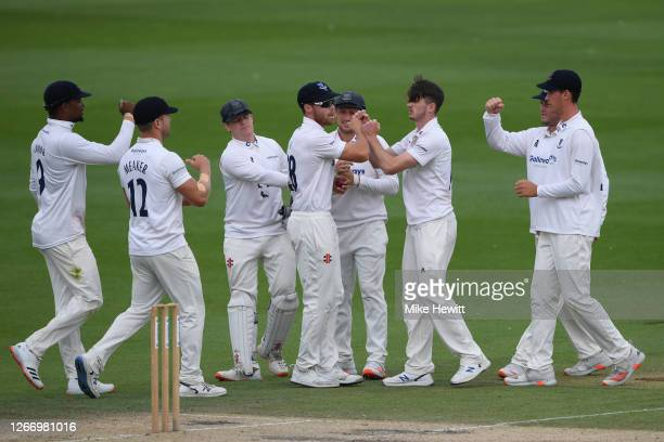 George Garton of Sussex celebrates with team mates after dismissing Alastair Cook of Essex during Day 4 of the Bob Willis Trophy match between Sussex...