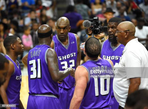 George Gervin head coach of Ghost Ballers huddles for a time out with Ivan Johnson Joe Smith Marcus Banks Ricky Davis and Mike Bibby during the BIG3...