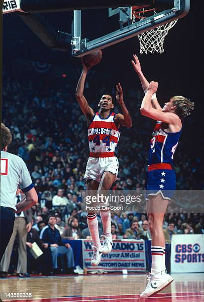 George Gervin of the San Antonio Spurs and the East All Stars shoots over Jack Sikma of the Seattle Supersonics and the West All Stars during the NBA...