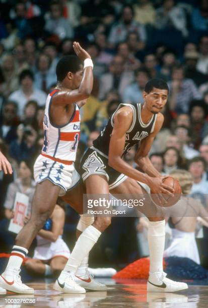 George Gervin of the San Antonio Spurs backs in on Tom Henderson of the Washington Bullets during an NBA basketball game circa 1978 at the Capital...