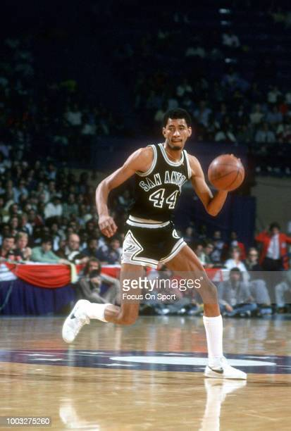 George Gervin of the San Antonio Spurs dribbles the ball against the Washington Bullets during an NBA basketball game circa 1978 at the Capital...