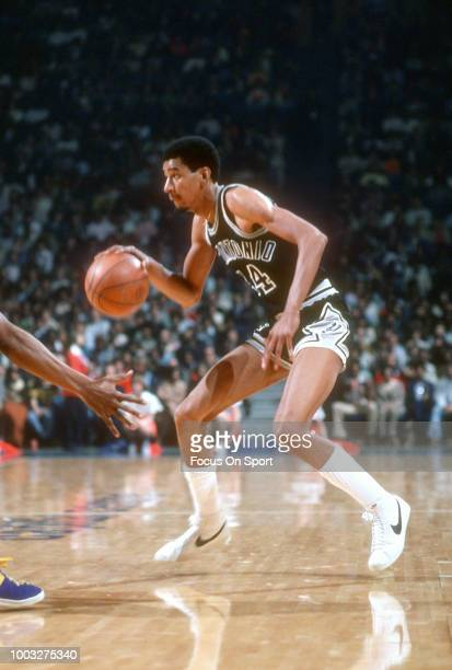 George Gervin of the San Antonio Spurs dribbles the ball against the Washington Bullets during an NBA basketball game circa 1979 at the Capital...
