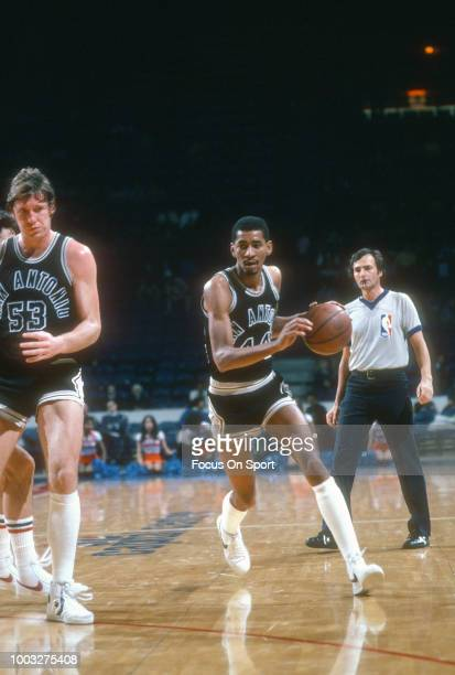 George Gervin of the San Antonio Spurs dribbles the ball against the Washington Bullets during an NBA basketball game circa 1982 at the Capital...