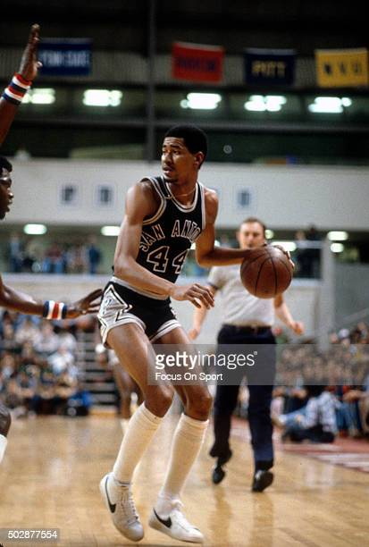 George Gervin of the San Antonio Spurs dribbles the ball against the New Jersey Nets during an NBA basketball game circa 1979 at the Rutgers Athletic...