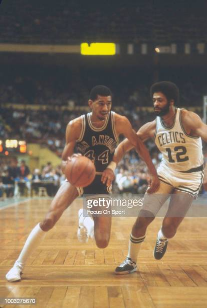 George Gervin of the San Antonio Spurs drives on Don Chaney of the Boston Celtics during an NBA basketball game circa 1979 at the Boston Garden in...