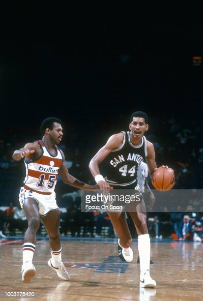 George Gervin of the San Antonio Spurs drives on Frank Johnson of the Washington Bullets during an NBA basketball game circa 1982 at the Capital...
