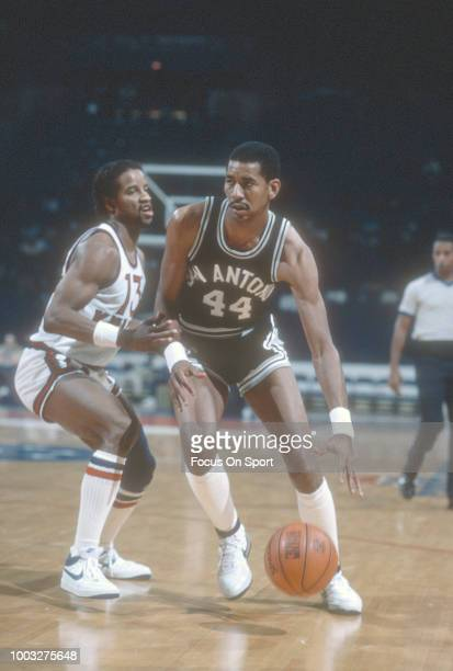 George Gervin of the San Antonio Spurs drives on Ray Williams of the New York Knicks during an NBA basketball game circa 1981 at Madison Square...