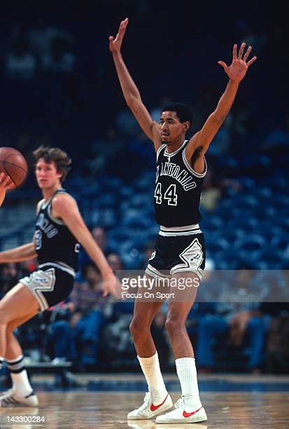 George Gervin of the San Antonio Spurs gets his hands up on defense against the Washington Bullets during an NBA basketball game circa 1978 at the...