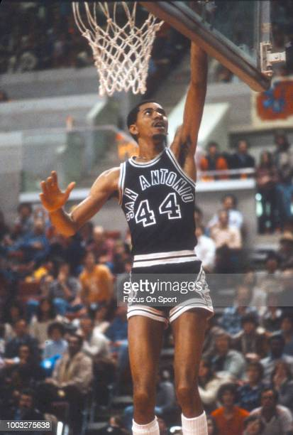 George Gervin of the San Antonio Spurs goes in for a layup against the New Jersey Nets during an NBA basketball game circa 1980 at the Rutgers...