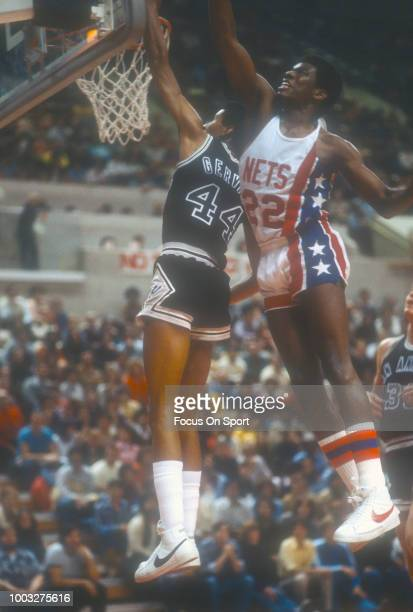 George Gervin of the San Antonio Spurs goes in for a layup over Bernard King of the New Jersey Nets during an NBA basketball game circa 1978 at the...
