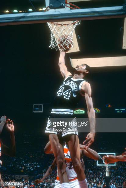 George Gervin of the San Antonio Spurs goes up for a slam dunk against the Washington Bullets during an NBA basketball game circa 1980 at the Capital...