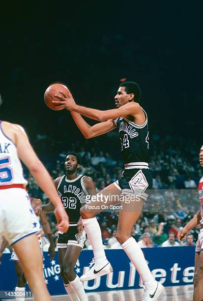 George Gervin of the San Antonio Spurs goes up to shoot against the Washington Bullets during an NBA basketball game circa 1980 at the Capital Centre...