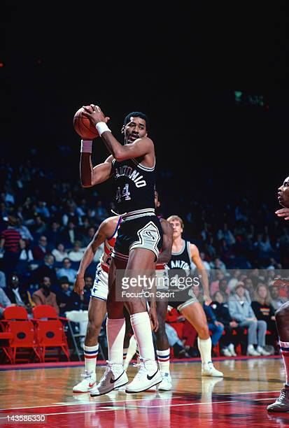 George Gervin of the San Antonio Spurs grabs a rebound against the Washington Bullets during an NBA basketball game circa 1984 at the Capital Centre...