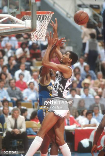 George Gervin of the San Antonio Spurs in action against the Golden State Warriors during an NBA basketball game circa 1981 at the HemisFair Arena in...