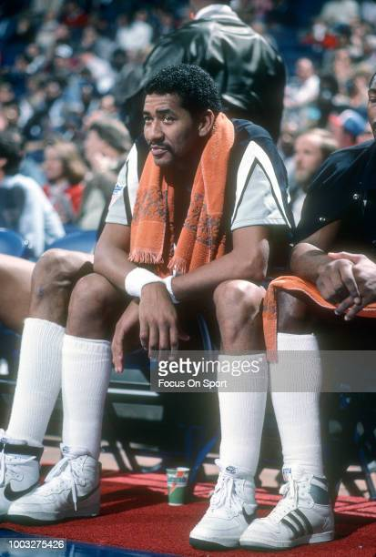George Gervin of the San Antonio Spurs looks on from the bench againt the Washington Bullets during an NBA basketball game circa 1982 at the Capital...
