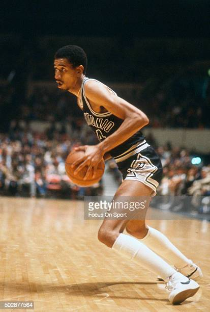 George Gervin of the San Antonio Spurs looks to drive to the basket against the New Jersey Nets during an NBA basketball game circa 1979 at the...