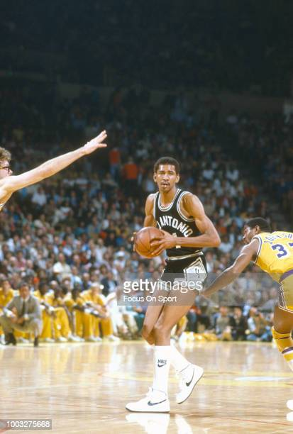 George Gervin of the San Antonio Spurs looks to pass the ball against the Los Angeles Lakers during an NBA basketball game circa 1981 at The Forum in...