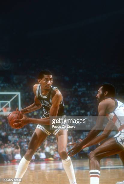 George Gervin of the San Antonio Spurs looks to put a move on Charles Johnson of the Washington Bullets during an NBA basketball game circa 1978 at...