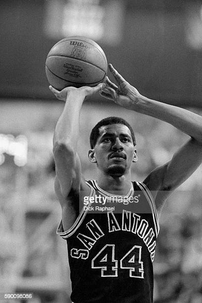 George Gervin of the San Antonio Spurs shoots a foul shot during a game against the Boston Celtics at the Boston Garden in Boston Massachusetts circa...