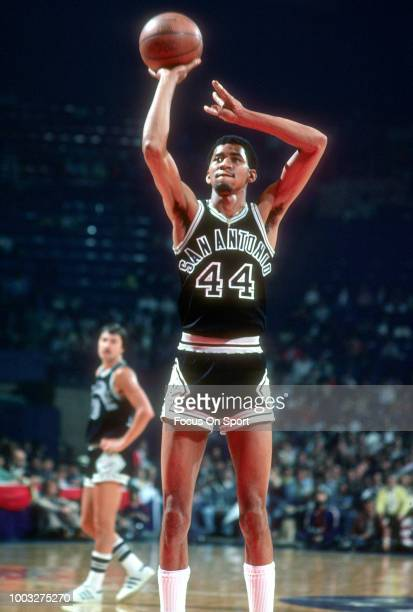 George Gervin of the San Antonio Spurs shoots a free throw against the Washington Bullets during an NBA basketball game circa 1978 at the Capital...