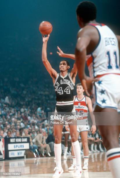 George Gervin of the San Antonio Spurs shoots a free throw against the Washington Bullets during an NBA basketball game circa 1980 at the Capital...