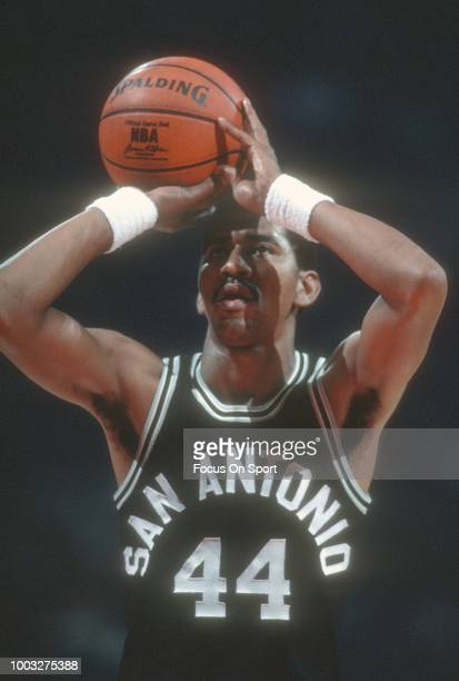 George Gervin of the San Antonio Spurs shoots a free throw against the Washington Bullets during an NBA basketball game circa 1982 at the Capital...