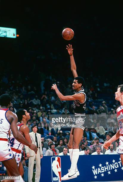 George Gervin of the San Antonio Spurs shoots a hookshot against the Washington Bullets during an NBA basketball game circa 1980 at the Capital...