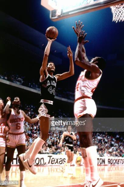 George Gervin of the San Antonio Spurs shoots a running one handed jump shot against the Houston Rockets during an NBA game in1984 at the Summit in...