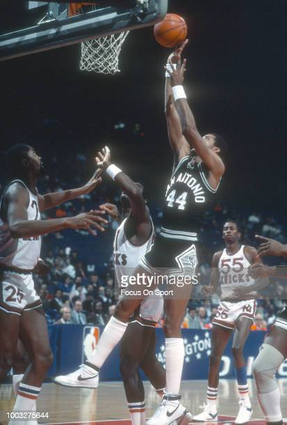 George Gervin of the San Antonio Spurs shoots against the New York Knicks during an NBA basketball game circa 1981 at Madison Square Garden in the...