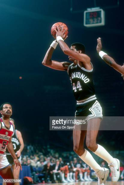 George Gervin of the San Antonio Spurs shoots against the Washington Bullets during an NBA basketball game circa 1982 at the Capital Centre in...