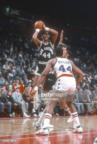 George Gervin of the San Antonio Spurs shoots against the Washington Bullets during an NBA basketball game circa 1984 at the Capital Centre in...