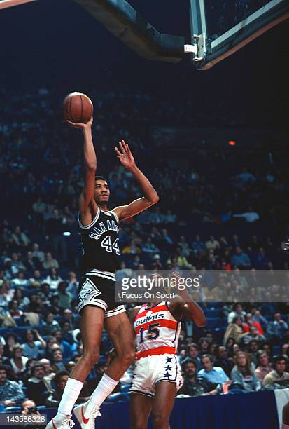 George Gervin of the San Antonio Spurs shoots over Charles Johnson of the Washington Bullets during an NBA basketball game circa 1978 at the Capital...