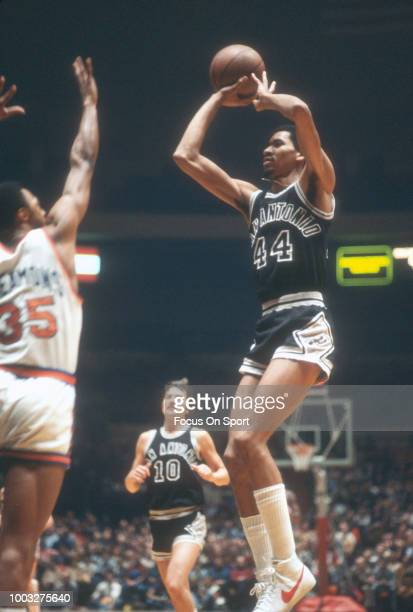 George Gervin of the San Antonio Spurs shoots over Jim Cleamons of the New York Knicks during an NBA basketball game circa 1978 at Madison Square...