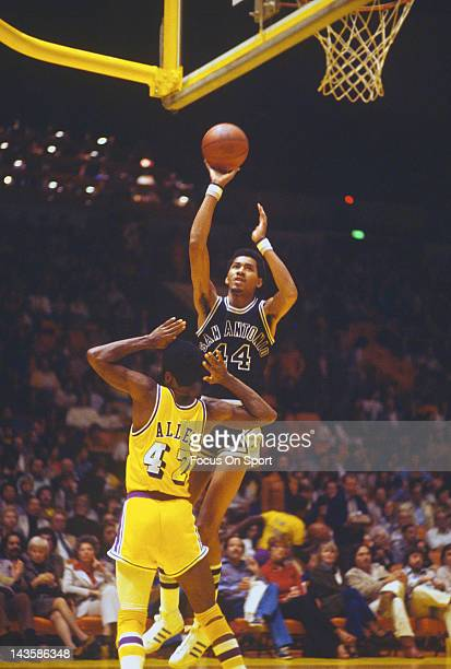 George Gervin of the San Antonio Spurs shoots over Lucius Allen of the Los Angeles Lakers during an NBA basketball game circa 1976 at The Forum in...