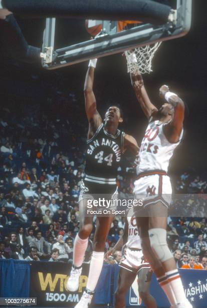 George Gervin of the San Antonio Spurs shoots over Marvin Webster of the New York Knicks during an NBA basketball game circa 1981 at Madison Square...
