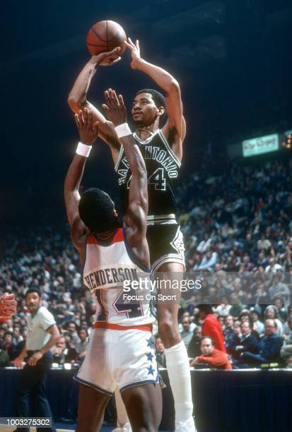 George Gervin of the San Antonio Spurs shoots over Tom Henderson of the Washington Bullets during an NBA basketball game circa 1978 at the Capital...