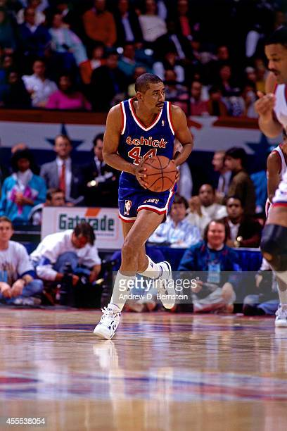 George Gervin of the West Legends team dribbles the ball against the East Legends team during the Schick Legends Classic at AllStar Weekend in 1991...