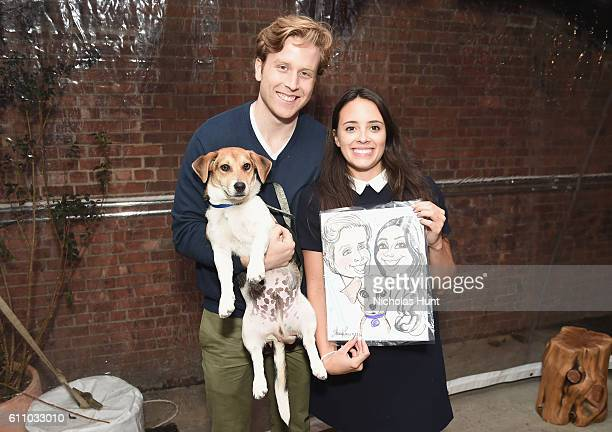 George Gibbons and Marie Gibbons pose with Teddy the dog during the celebration of the launch of Rachael Ray's Nutrish DISH with a Puppy Party on...