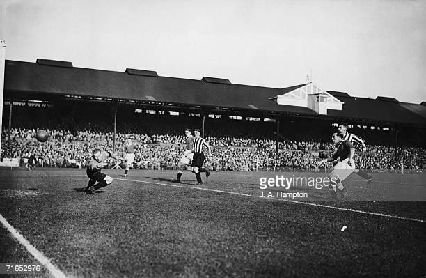 George Gibson beats Sunderland goalkeeper Jimmy Thorpe to score Chelsea's second goal at Stamford Bridge, London, 28th September 1935. Chelsea won...