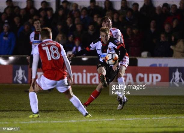 George Glendon of Chorley shoots at goal during The Emirates FA Cup First Round match between Chorley and Fleetwood Town at Victory Park on November...