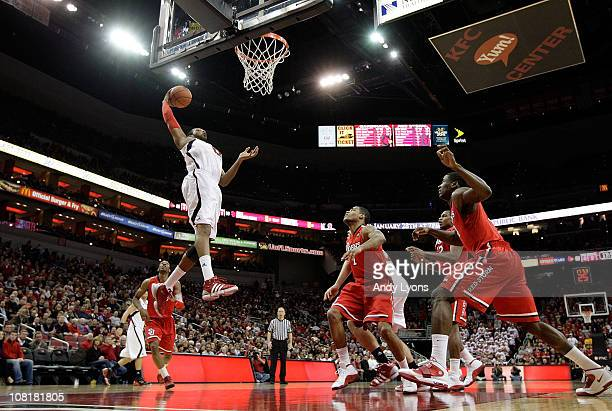 George Goode of the Louisville Cardinals grabs a rebound during the Big East Conference game against the St. John's Red Storm at the KFC Yum! Center...