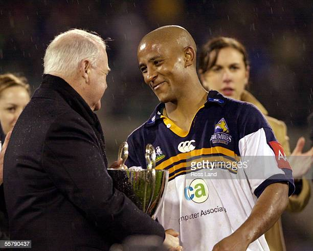 George Gregan accepts the trophy from Australian Govenor General Sir William Dean at the official presentation after the Super12 rugby final won 366...