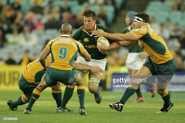 George Gregan and Guy Shepherdson of the Wallabies tackle Bob Skinstad during of the Springboks during the 2007 Tri Nations match between Australian...